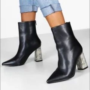 Black ankle boots with snake skin heel